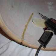Crock repair using beeswax melted with a soldering iron. Photo by Gary Schu