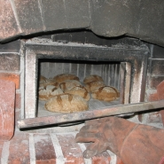 Bread ready to come out of Brian Thomas' wood-fired oven.