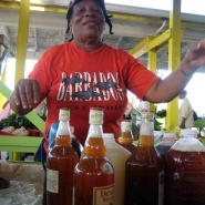 A mauby-maker at a St. Croix (U.S. Virgin Islands) market.