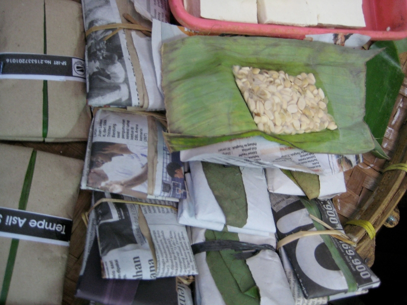 Partially fermented tempeh for sale in a Javanese market. Bring it home and the next day it's ready to eat.