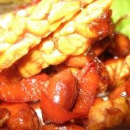 Fried tempeh matchsticks with peanuts and a sweet, sour, salty sauce.