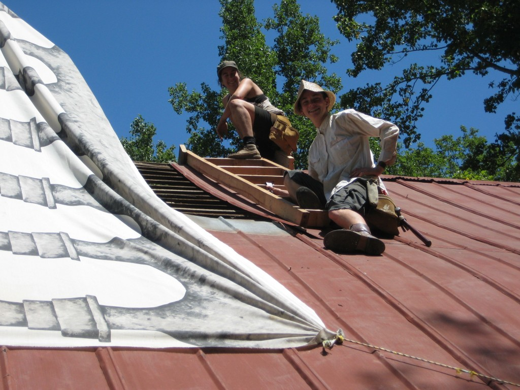 Jen and Sarah beginning to deconstruct the roof around the chimney, so the pointers can access the top of the chimney. Roof will be replaced later in the summer.