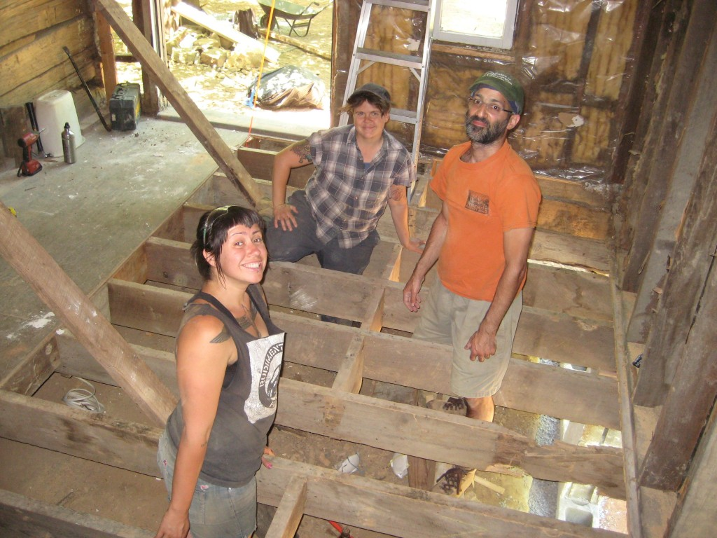 Josefina, Kayvon, and Kassidy ripping up a termite-damaged floor.