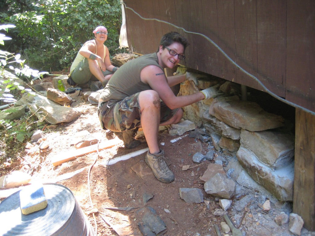 Alicia and Fish laying stones for the new foundation walls (where there had been none).