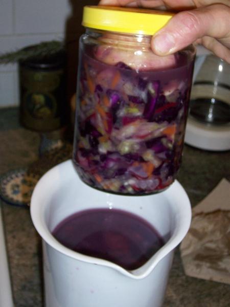Kraut Jar Weighing down Kraut in Larger Vessel