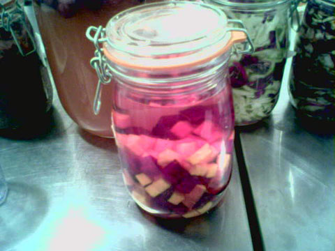 Beet kvass early in the process, as color and sugars from the beets begin to infuse the solution.