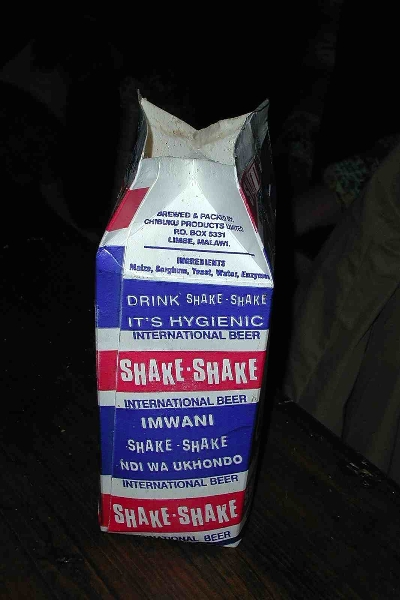 "Sorghum beer from a Malawi brewery, sold in waxed paper cartons, like milk. The name ""Shake, Shake\"" is what you do to the beer before opening the carton to re-integrate starch that settles. Photo by Glenn Austerfield"
